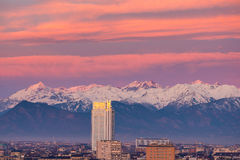 Torino Turin, Italy: cityscape at sunrise woth the new skyscraper towering over the city. Scenic colorful light on the snowcappe Royalty Free Stock Photos