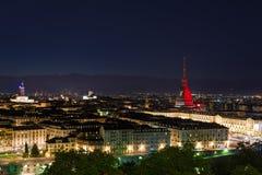 Torino (Turin, Italy), garnet colored Mole Antonelliana. Turin, Italy - May 4, 2016: Night cityscape of Torino (Turin, Italy). The Mole Antonelliana glowing with stock photo