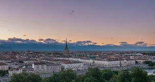 Torino Turin, Italy skyline with the Mole Antonelliana towering over the buildings. Timelapse fading from sunset to dusk, turnin stock video