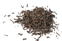 Torka svarta teblad som isoleras på vit bakgrund Arkivbild