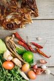 Torkade fisk och kryddor på trä Royaltyfria Bilder