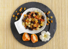 Torkade frukter på stenen pläterar med blomman Royaltyfria Bilder