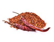 Torkade peppar för varm chili mot en vit bakgrund Arkivbild
