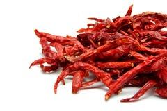 Torkade röda Chili Peppers på vit bakgrund Royaltyfri Bild