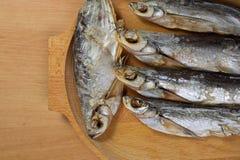 Torkade sabrefish På tabellen royaltyfri bild