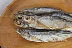 Torkade sabrefish På tabellen royaltyfri foto