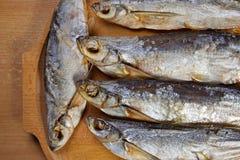 Torkade sabrefish På tabellen royaltyfria foton