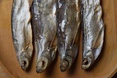 Torkade sabrefish På tabellen arkivfoto