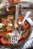 Torkade tomater och rosmarin Arkivbilder