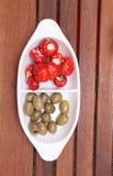 Torkade tomater, olivgrön och peppar royaltyfria foton