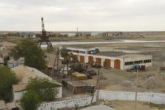Torkat upp port på den Aral havskusten i Aralsk, Kasakhstan Royaltyfri Bild