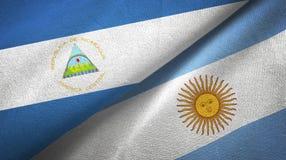 Torkduk f?r Nicaragua och Argentina tv? flaggatextil, tygtextur royaltyfri illustrationer