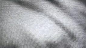 Torkdukefladdranden Vågor av kanfasanimeringen Bakgrund av satängtyg Tygbakgrundsanimering som fladdrar i royaltyfri foto
