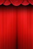 torkduken hänger upp gardiner den röda teatern Royaltyfri Foto