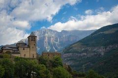 Torla Ordesa, church with the mountains at bottom, Pyrinees Spain royalty free stock photos