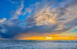 tormenta del claro en la puesta del sol Foto de archivo libre de regalías