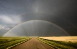 Tormenta y arco iris del granizo de la pradera Foto de archivo libre de regalías