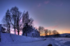 Tormore Whiskey Distillery. In the middle of winter with the sun setting stock images