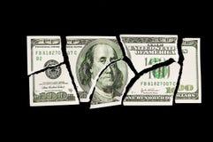 Torn 100 dollar bill. Over dark background royalty free stock image