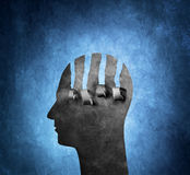 Torn. A Torn artistic cardboard head on blue background royalty free stock image