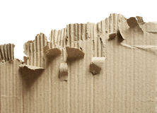 Torn. Brown corrugated cardboard on white background royalty free stock photography