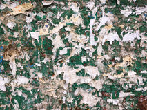 Torn advertisement on green metal wall  texture Stock Images