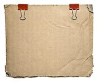 Torn Aged Cardboard With Red Clips Royalty Free Stock Image