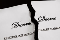 Torn apart. Divorce decree document torn apart Stock Photography