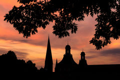 Torn av bakgrund för bonn Tyskland aftonsolnedgång Royaltyfria Bilder