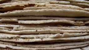 Torn av kassavabröd Royaltyfria Bilder