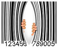 Torn Bar Code. Big bar code torn apart in the middle by two hands - Consumerism concept Royalty Free Stock Photos