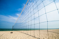 Torn beach volleyball net Stock Photos