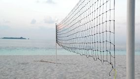 Torn beach volleyball net at tropical beach stock footage