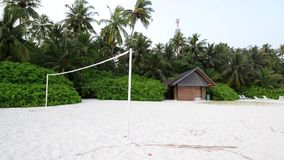 Torn beach volleyball net at tropical beach stock video
