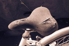 Torn bicycle seat Royalty Free Stock Image