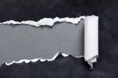 Torn black paper with grey space for message. Torn black parchment with grey space for your message royalty free stock image