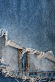 Torn blue jeans Royalty Free Stock Photos