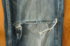 Torn blue jeans Stock Photos