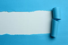 Torn Blue Paper. With white on the background royalty free stock photo