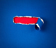 Torn blue Paper and space for text with red paper background Stock Image