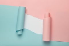 Torn blue and pink colored paper Stock Images
