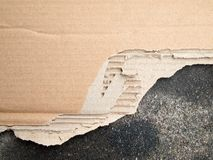 Torn brown cardboard paper Stock Photos