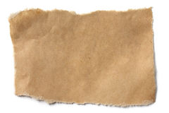 Torn Brown Paper. Casting natural shadow on white Royalty Free Stock Photo