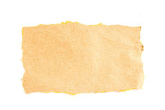 Torn brown paper casting natural shadow on white Stock Photography