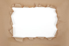 Torn brown paper frame royalty free stock photography