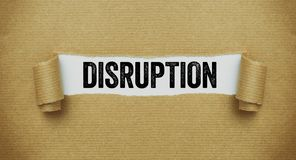 Free Torn Brown Paper Revealing The Word Disruption Stock Photos - 157018473