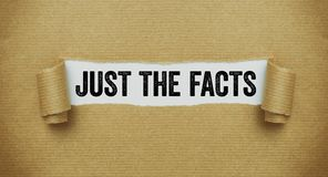 Free Torn Brown Paper Revealing The Words Just The Facts Royalty Free Stock Photography - 142598097