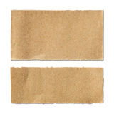 Torn brown paper sheet on white Stock Photography