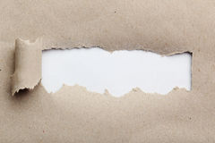 Torn brown paper. For text, close up stock image