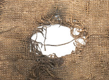 Torn burlap decayed Stock Images